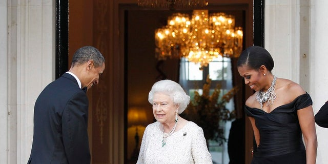 Former President Barack Obama and first lady Michelle Obama met with Queen Elizabeth II in 2011.