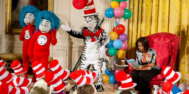 "First lady Michelle Obama, with Dr. Seuss characters the Cat in the Hat, Thing 1, and Thing 2, reads to local students as part of her ""Let's Move, Let's Read!"" initiative, Wednesday, Jan. 21, 2015, in the East Room of the White House in Washington. The book, Dr. Seussís ""Oh, The Things You Can Do That Are Good for You: All About Staying Healthy,"" has been updated with the help of the Partnership for a Healthier America and includes healthy foods and exercises. (AP Photo/Jacquelyn Martin)"