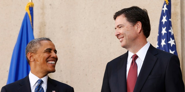 Former President Barack Obama and James Comey on the day he was sworn in as FBI director in 2013.