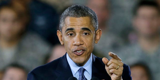 Dec. 15, 2014: President Obama speaks to military members and families at Joint Base McGuire-Dix-Lakehurst, in Wrightstown, N.J.
