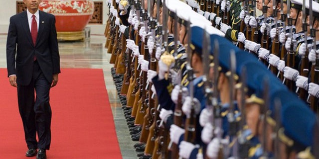 Nov. 17: President Barack Obama walks past an honor guard at a welcoming ceremony at the Great Hall of the People prior to meetings in Beijing. (AFP)