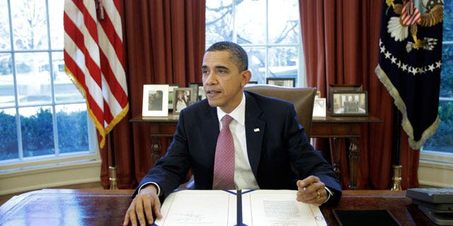 President Obama signs the two-week funding bill averting a government shutdown in the Oval Office at the White House in Washington, Wednesday, March 2, 2011. (AP)