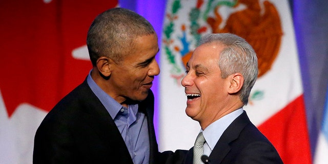 Former President Barack Obama, left, shares a laugh with Chicago Mayor Rahm Emanuel after Emanuel introduced Obama at a summit on climate change involving mayors from around the globe on Dec. 5, 2017, in Chicago.