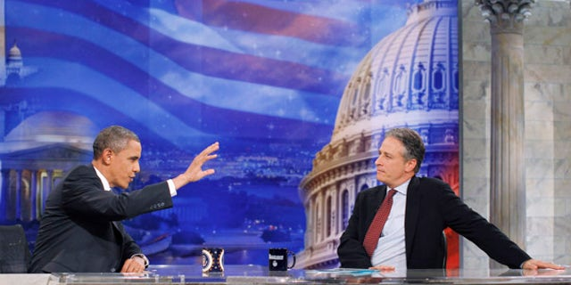 """Wednesday: President Obama gestures during a commercial break as he talks with host Jon Stewart at a taping of Comedy Central's """"The Daily Show with Jon Stewart,"""" in Washington."""