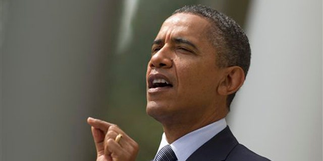 President Obama gestures while speaking in the Rose Garden of the White House in Washington Sept. 19.