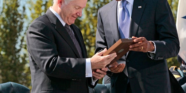 Thursday: President Obama presents the Presidential Medal of Freedom to retiring Defense Secretary Robert Gates during an Armed Forces Farewell Tribute at the Pentagon.