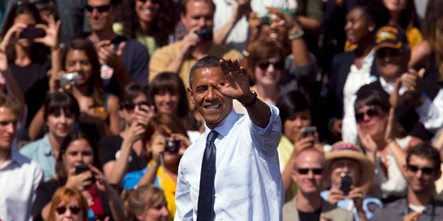 Sept. 13, 2012: President Obama waves after speaking at a campaign rally in Golden, Colo.