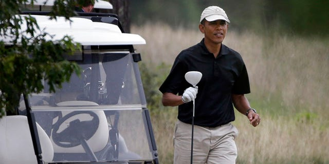Aug. 18, 2013: President Obama prepares to tee off while golfing at Vineyard Golf Club in Edgartown, Mass.