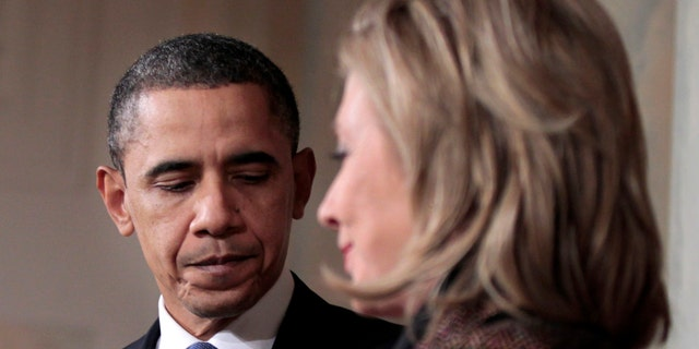 Wednesday: President Obama and Secretary of State Hillary Clinton walk away from the podium after delivering a statement on Libya in the Grand Foyer of the White House in Washington.