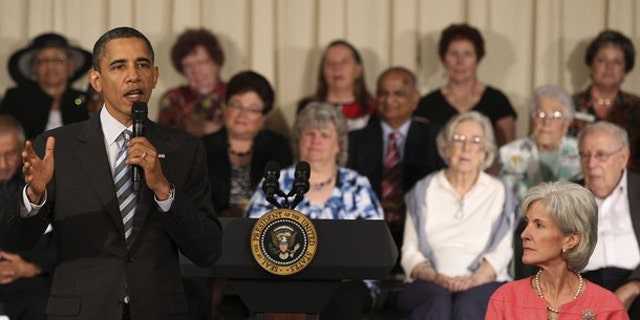 President Obama speaks next to Health and Human Services (HHS) Secretary Kathleen Sebelius (R) as he holds a town hall meeting at the Holiday Park Multipurpose Senior Center, June 8, 2010. (Reuters)