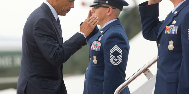 President Barack Obama returns a salute as he boards Air Force One, Thursday, June 16, 2016, at Andrews Air Force Base, Md. Obama will visit Orlando, Fla. to pay respects to the victims of the Pulse nightclub shooting and meet with families of victims of the attack. (AP Photo/Pablo Martinez Monsivais)