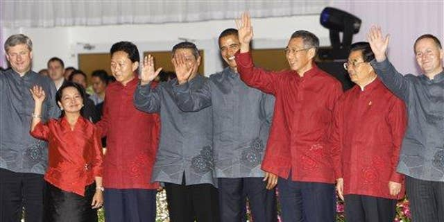 President Obama poses with other APEC leaders for their official group photo during the Gala Dinner at the APEC Summit in Singapore. (AP Photo)