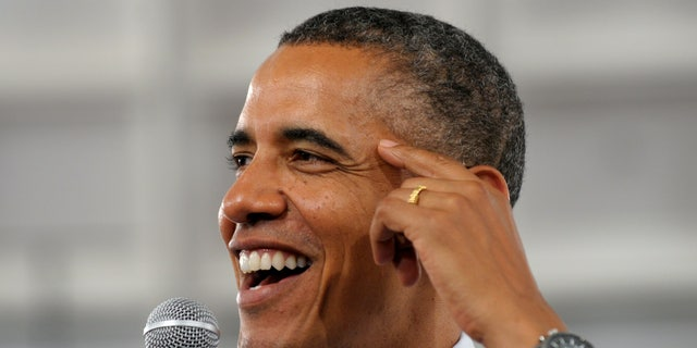 President Barack Obama responds to a question from a member of the audience during a campaign event.