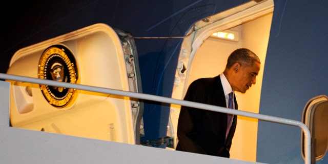 Dec. 9, 2014: President Obama boards Air Force One in Nashville, Tenn. after speaking there about his executive actions on immigration. (AP)
