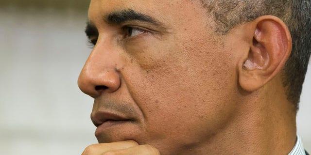 Sept 18, 2014: President Barack Obama listens to Ukrainian President Petro Poroshenko speak after a meeting in the Oval Office of the White House. (AP)