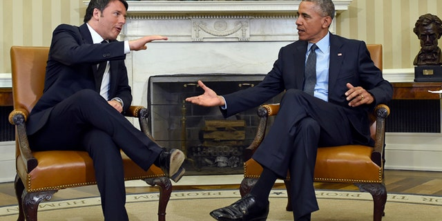 April 17, 2015: President Obama reaches to shake hands with Italian Prime Minister Matteo Renzi in the Oval Office.