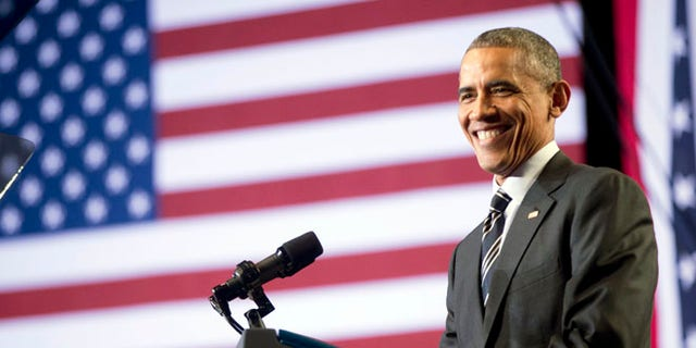 Nov. 25, 2014: President Barack Obama smiles while speaking at the Copernicus Community Center in Chicago to discuss immigration reform. (AP)
