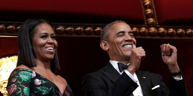 US President Barack Obama gestures as he and first lady Michelle Obama attend the Kennedy Center Honors in Washington, U.S., December 4, 2016.