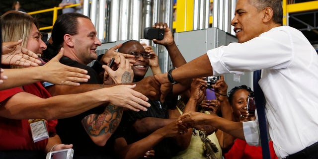 July 30, 2013: President Obama shakes hands before speaking to employees after he tours the Amazon Fulfillment Center in Chattanooga, Tennessee.