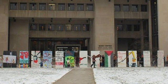 """Pro-Palestine activists erected this """"apartheid wall"""" in front of the entrance to a library on the Oberlin campus."""