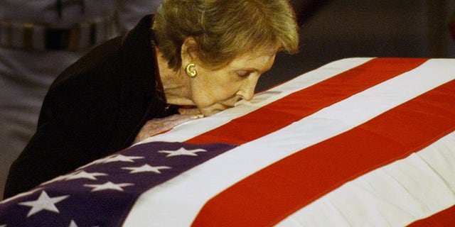 June 11, 2004: Nancy Reagan kisses the casket of her husband, former President Ronald Reagan.