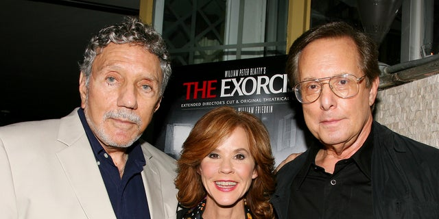 "In this Sept. 29, 2010 file photo released by Starpix, ""The Exorcist"" author William Peter Blatty, left, joins Linda Blair, who starred in the 1973 film and William Friedkin, the film's director, at a screening of the remastered film at the Museum of Modern Art in New York."