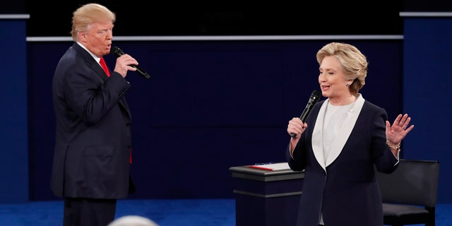 October 9, 2016: Republican presidential nominee Donald Trump and Democratic presidential nominee Hillary Clinton speak during their presidential town hall debate at Washington University in St. Louis, Missouri.