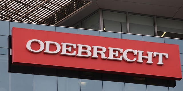 A sign of the Odebrecht Brazilian construction conglomerate is seen at their headquarters in Lima, Peru.