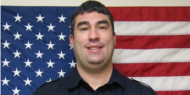 Topeka, Kansas police Officer Aaron Bulmer, who sprang into action when a 4-year-old boy with autism fell into a pond.