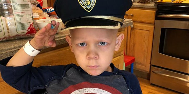 Surrounded by family and friends, 4-year-old honorary Colorado Springs Police Officer Joshua Salmoiraghi finished his last round of chemotherapy Sunday.
