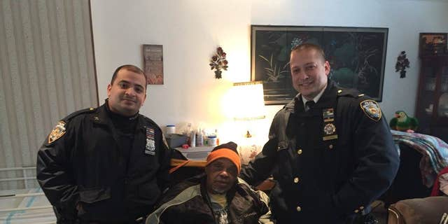 NYPD Lt. Vitaliy Zelikov (left) and Officer Georin Duran (right) pose with an 85-year-old man who says he was a Navy veteran.