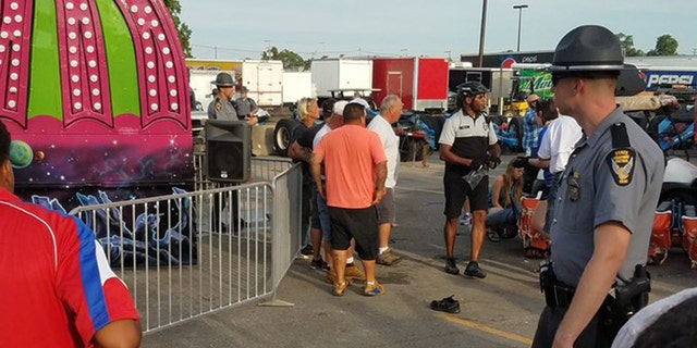 Authorities respond after the Fire Ball amusement ride malfunctioned injuring several at the Ohio State Fair, Wednesday, July 26, 2017, in Columbus, Ohio.