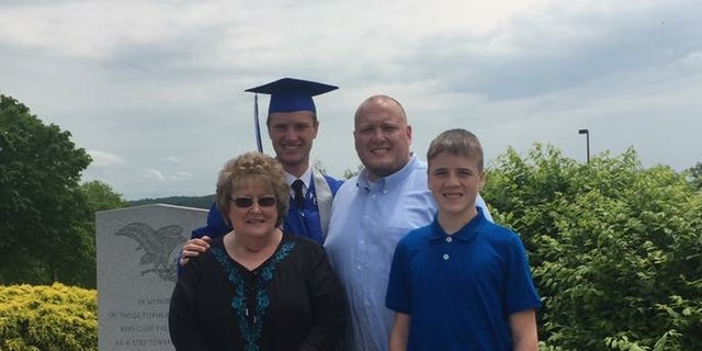 East Liverpool High School graduate Bobby Hill with his grandmother Barbara Hill, father Robert and brother Jonathan.