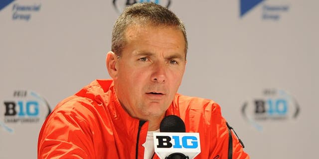 INDIANAPOLIS, INDIANA - DECEMBER 7, 2013: Head coach Urban Meyer of the Ohio State Buckeyes answers questions from the media during the post game press conference after a game against the Michigan State Spartans at Lucas Oil Stadium in Indianapolis, Indiana. The Spartans won 34-24. (Photo by David Dermer/Diamond Images/Getty Images)