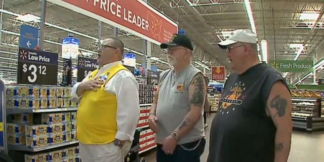 Walmart greeter Freddy Davidson takes the extra step to honor veterans at the store in Chadron, Ohio.