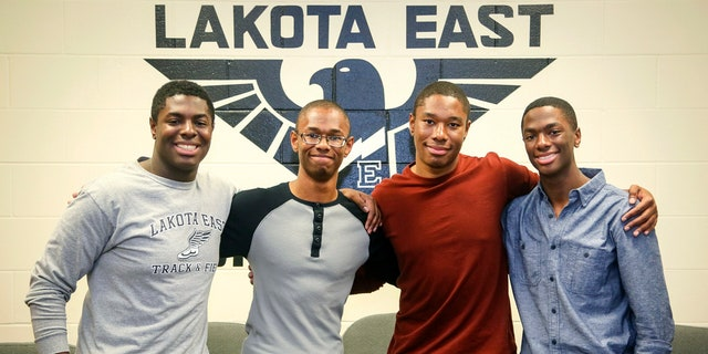Lakota East seniors and quadruplet brothers from left, Nick, Nigel, Zachary, and Aaron Wade pose together at Lakota East High School, in Liberty Township, Ohio, Wednesday, April 5, 2017. All the brothers have been accepted at some of the nation's top universities, including each of them to both Yale and Harvard. (Greg Lynch /The Journal-News via AP)