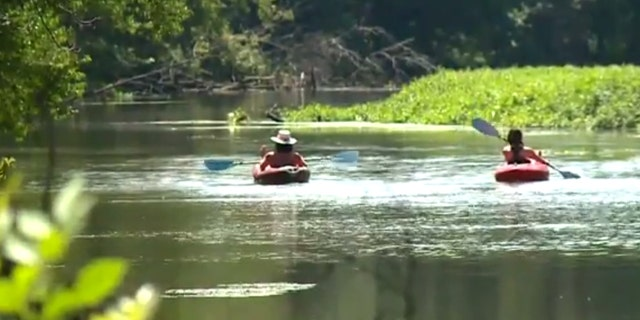 The teammates rescued the elderly couple from the Cuyahoga River in Ohio.