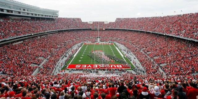 File photo - The Ohio State University football team takes the field prior to the start of their NCAA football game against the University of Illinois in Columbus, Ohio, Nov. 10, 2007. (REUTERS/Matt Sullivan)