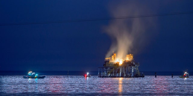 Jefferson Parish, La., authorities and others from other parishes respond to an oil rig explosion in Lake Pontchartrain off Kenner, La., Sunday, Oct. 15, 2017.