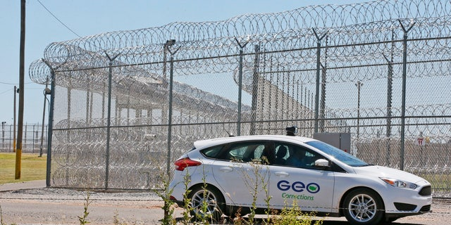 A GEO corrections vehicle patrols outside of the Great Plains Correctional Facility in Hinton, Okla, Monday, July 10, 2017.