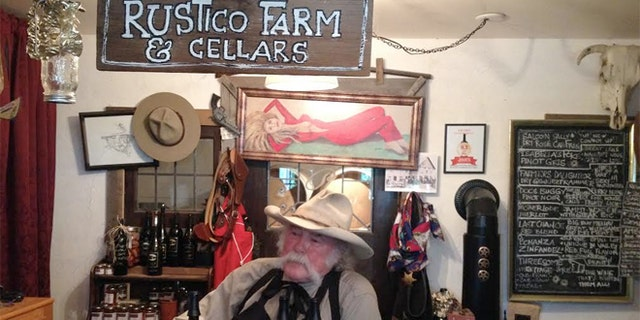 Owner Bruce Fuller, owner of Rustico Farm & Cellars, wearing his a worn cowboy hat.