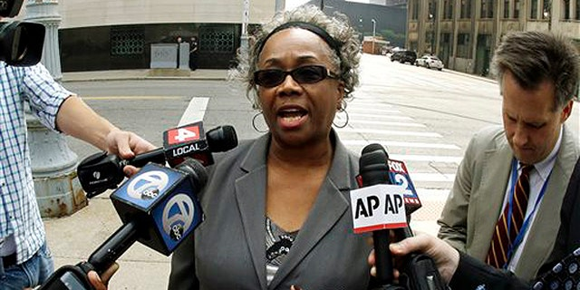 Sept. 19, 2013: Detroit resident Olivia Gillon addresses the media outside federal court in Detroit after attending a Detroit bankruptcy hearing.