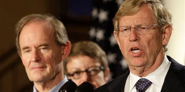 Attorney Theodore Olson, right, speaks next to attorney David Boies at a news conference in San Francisco Aug. 4. (AP Photo)