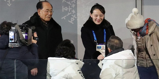 South Korean President Moon Jae-in shakes hands with Kim Jong Un's younger sister, Kim Yo Jong, at the Winter Olympics.