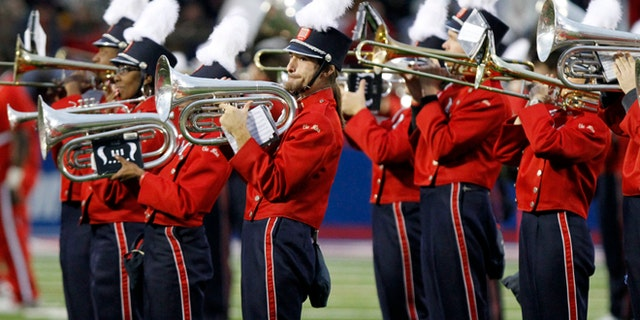 """In this Oct. 17, 2009 photo taken before the NCAA college football game in Oxford, Miss., the University of Mississippi band, """"The Pride of the South,"""" play the national anthem in Oxford, Miss."""