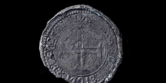 This undated photo made available by Blue Water Recoveries company on Tuesday, March 15, 2016 shows a rare silver coin called an Indio discovered from the debris of the explorer Vasco da Gama's ship, Esmeralda which sank in a storm in May 1503 off the coast of Al Hallaniyah island in Oman's Dhofar region. (Blue Water Recoveries company via AP)