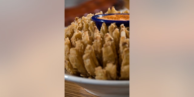 deep fried onion flower with dipping sauce
