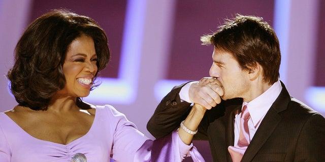 Oprah Winfrey with Tom Cruise in 2004.