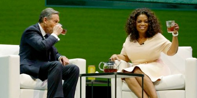 March 19, 2014: Howard Schultz, left, chairman and CEO of Starbucks Coffee Company, sits and drinks tea with Oprah Winfrey, right, to announce their partnership to offer Teavana Oprah Chai tea, Wednesday.
