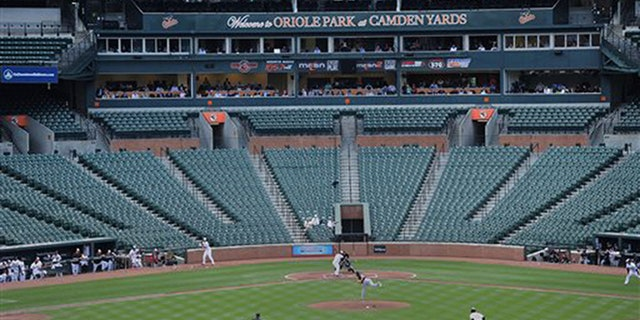 The Baltimore Orioles bat against the Chicago White Sox during a baseball game without fans Wednesday, April 29, 2015, in Baltimore.